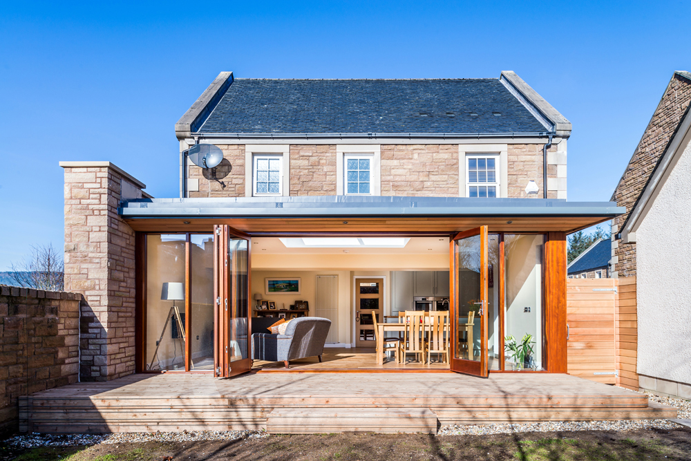 single storey rear extension with glazed bifold doors opening onto deck, Scottish Borders, Cumbria