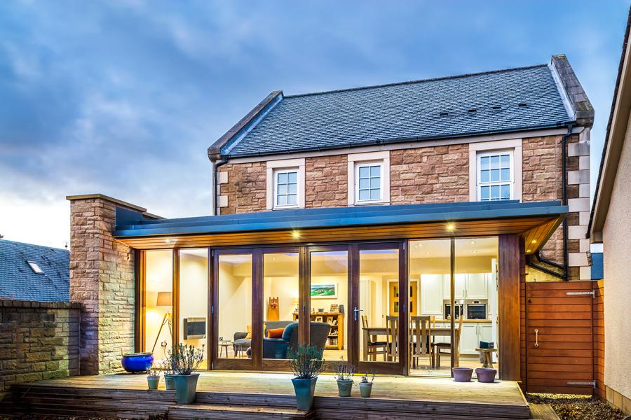 rear extension to modern house, folding doors, glass wall, Scotland