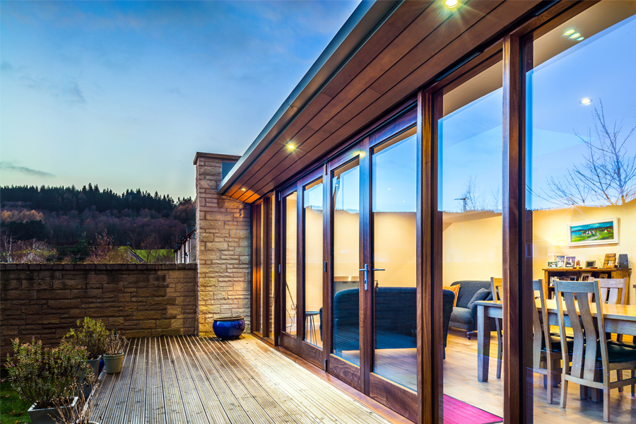 folding doors, timber decking, stone wall, modern house extension, Scottish Borders