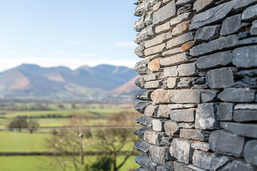 Stone clad extension with view of Keswick Cumbria