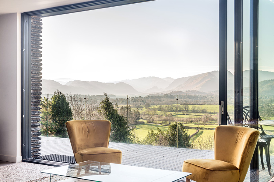 raised terrace with glass balustrade and aluminium sliding doors Lake District