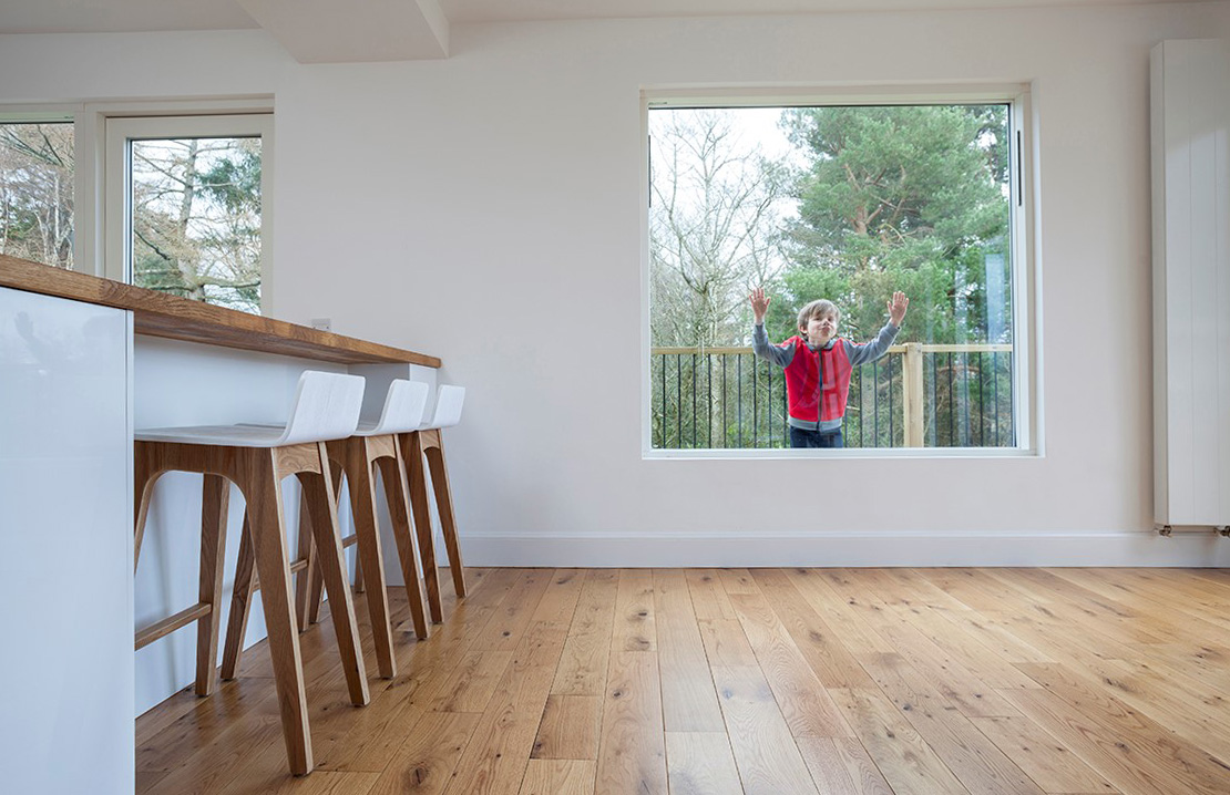 internal alterations, open plan dining room with breakfast bar and child looking through window