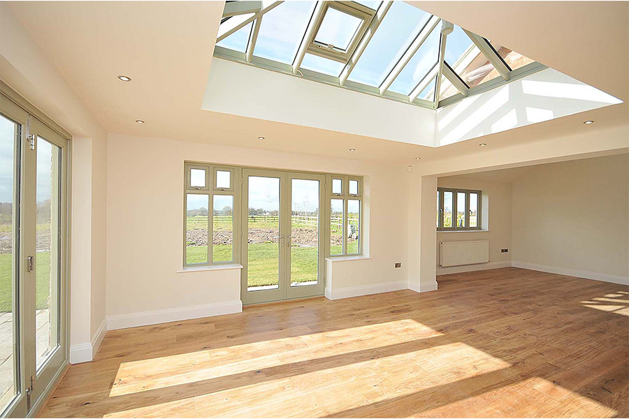 internal view of orangerie with folding doors and skylight, house remodel cheshire