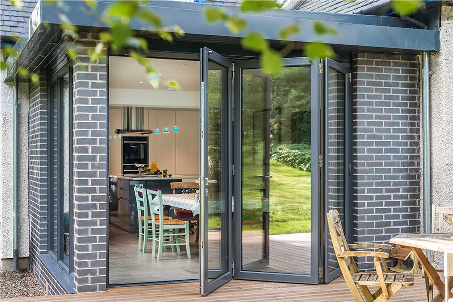 Bifold doors, timber decking, dining room, Scottish Borders extension
