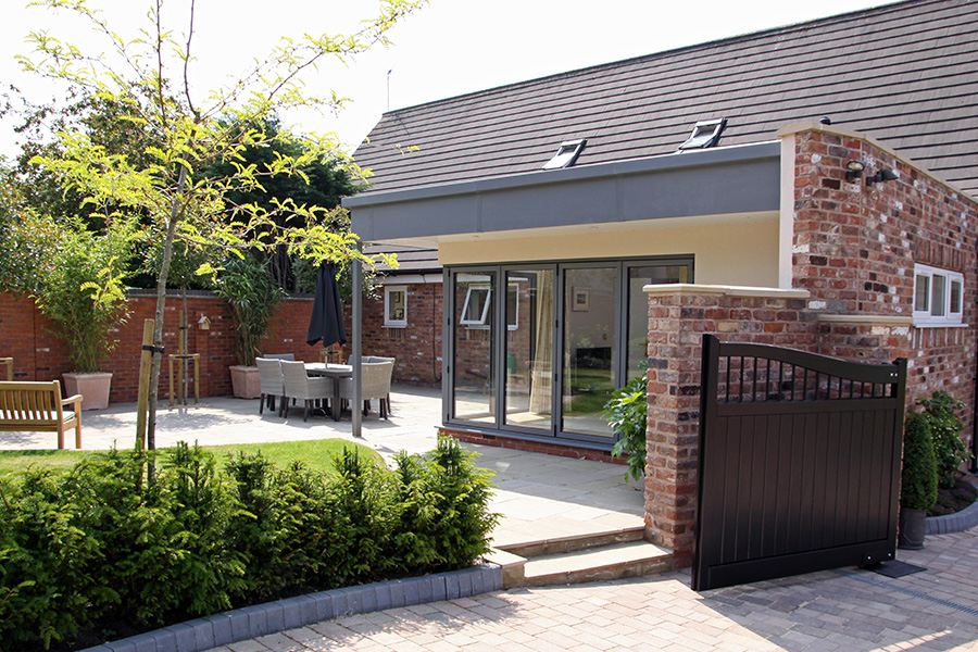 sliding folding doors of garage conversion to garden room, driveway, Lymm, Cheshire