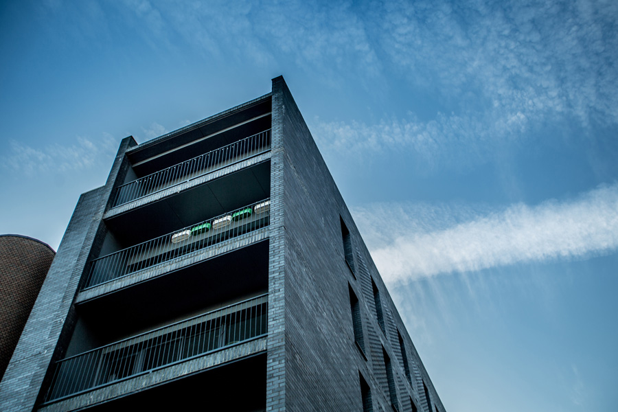 residential development, townhouses in black brick with glass balconies, mccauls, manchester