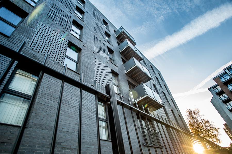 brick residential development with balcony flats, rochdale canal, new islington