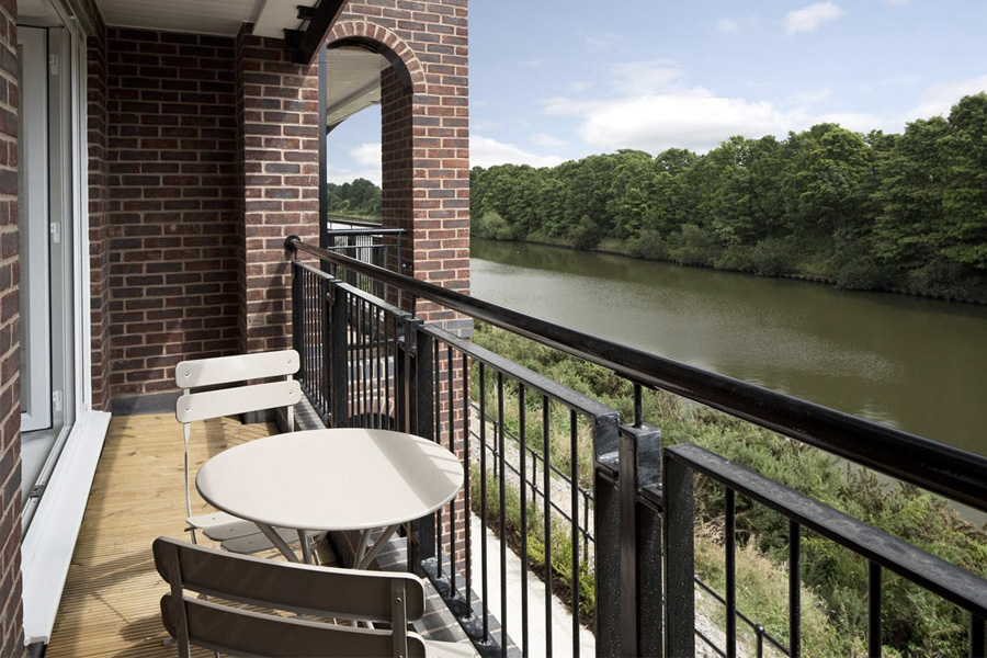 apartment balcony overlooking manchester ship canal , warrington