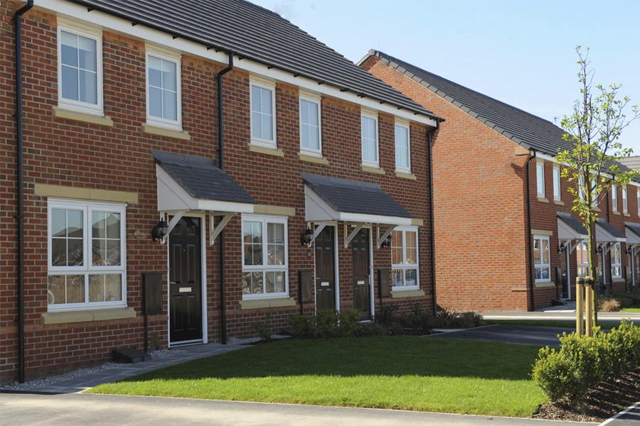 red brick, semi detached houses, pitched roof, Manchester, development