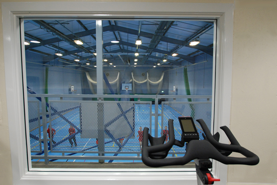 View of refurbished sports hall from new school gym facilities