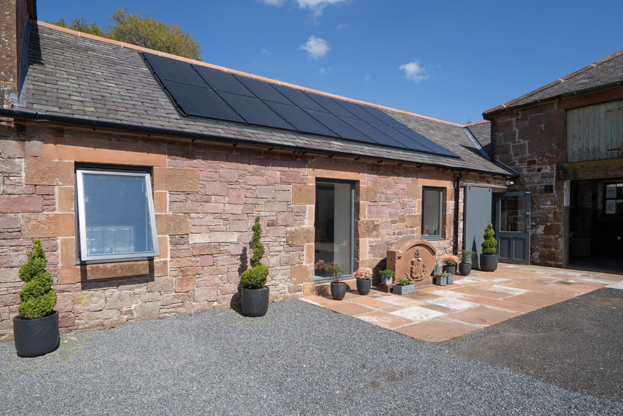 Ninefold Distillery housed in historic steading conversion, PV panels Stone building