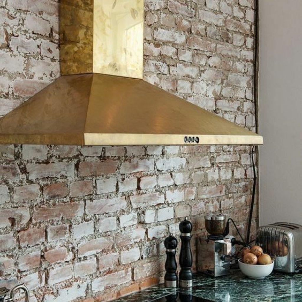 detail of brass kitchen extract hood fan