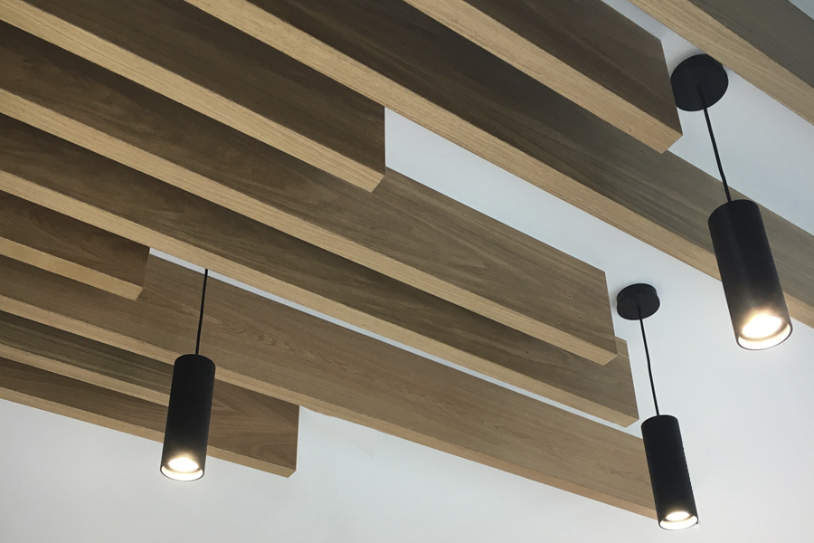timber slatted ceiling feature with pendant light fittings for office reception redesign East lothian cb3 design interiors Peebles