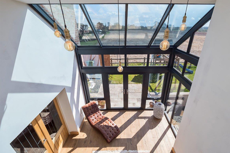 double height hallway with glass wall and glass roof, New build House, Cheshire, cb3design architects