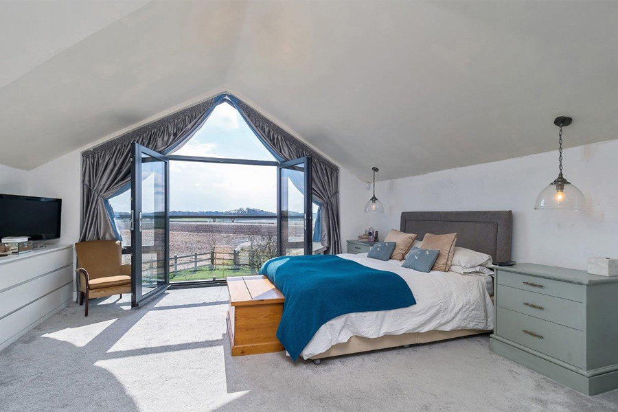 masterbedroom with glazed gable wall, newbuild house, Tower Lane, Lymm, Cheshire, cb3 design architects