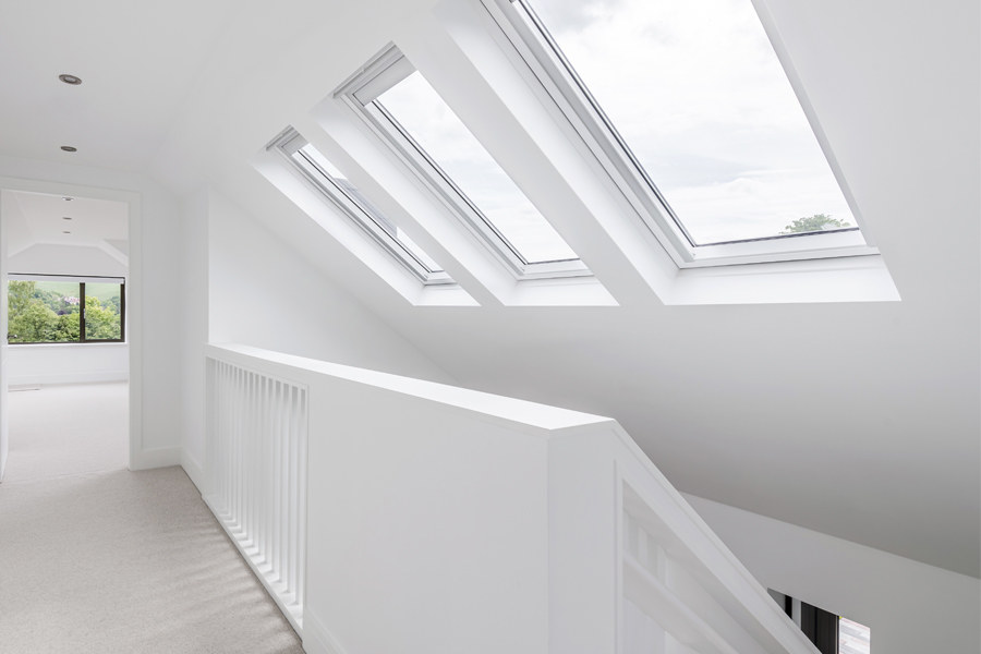 open stair with velux rooflights above and bespoke balustrade
