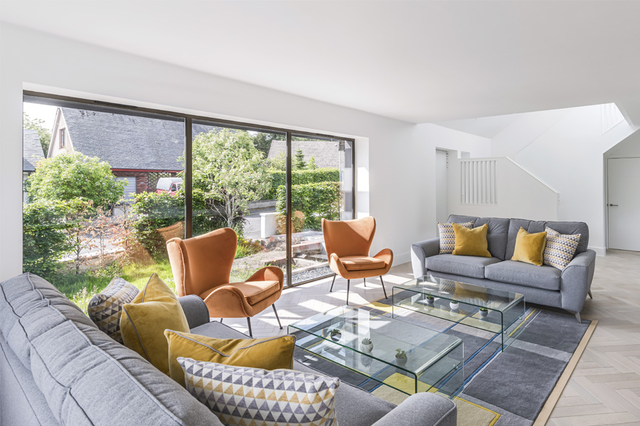 open plan living room with corner sofas and Egg chair