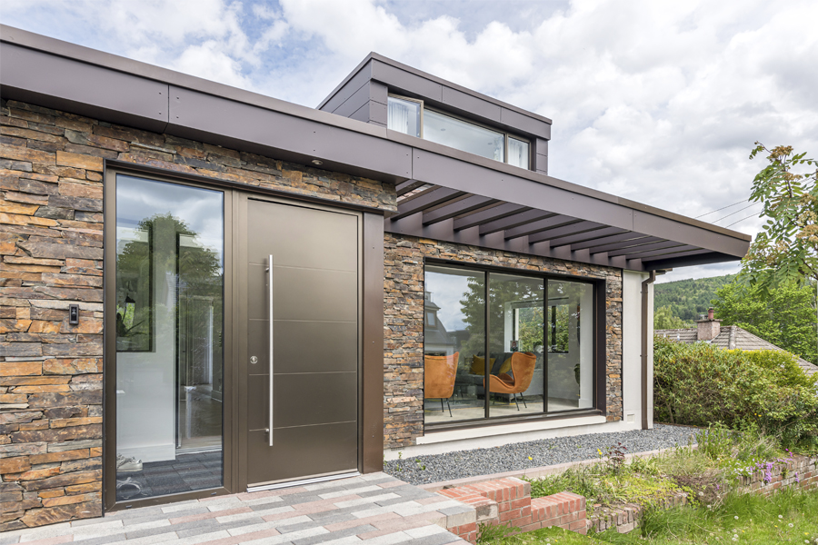 bronze cladding panels and layered stone facing on refurbished 1960s bungalow, peebles, Scottish Borders Architects, dormer windows and terrace canopy