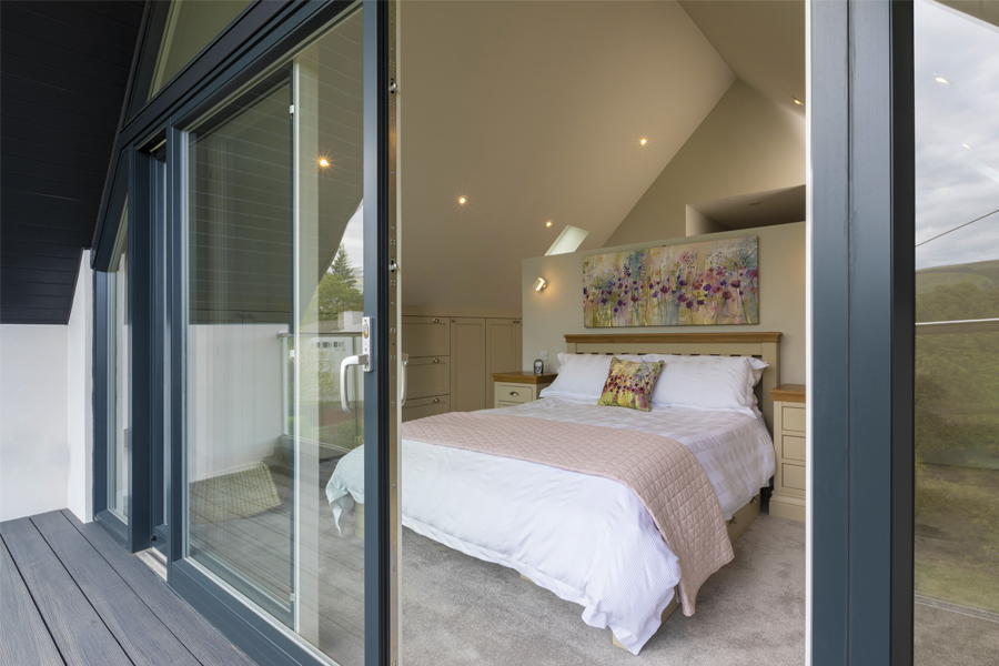 master bedroom viewed through sliding glass doors from coverd balcony, edinburgh extension, cb3 design peebles
