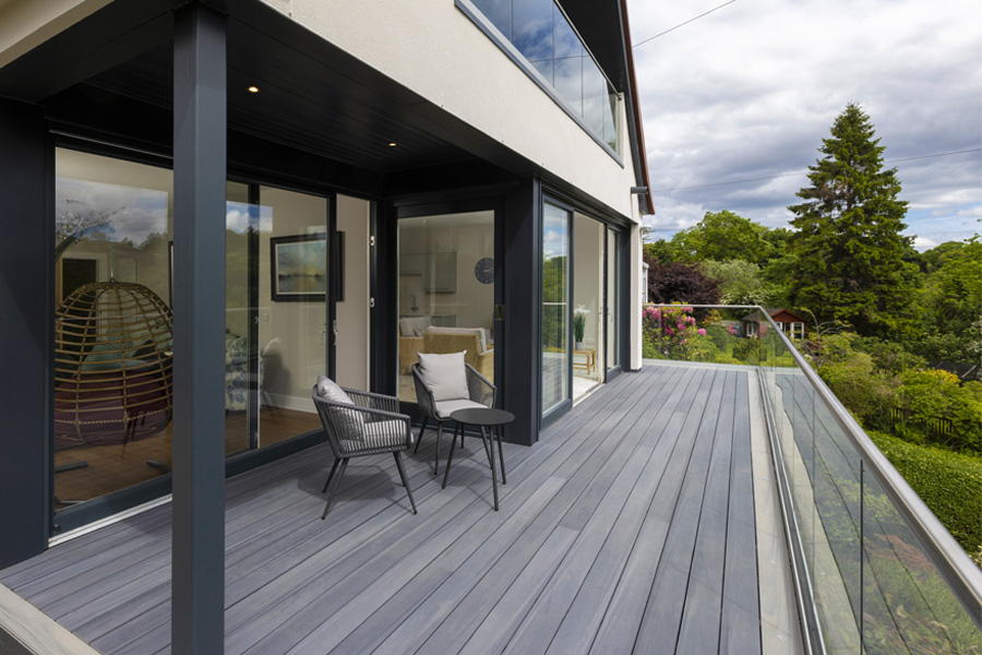 decking area with covered seating area, glass balustrades, composite decking boards