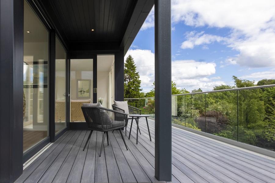 covered terrace with composite decking boards, sliding glass screens, glass balustrade, edinburgh extension